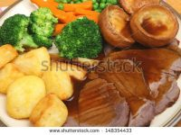 stock-photo-traditional-roast-beef-sunday-dinner-148354433